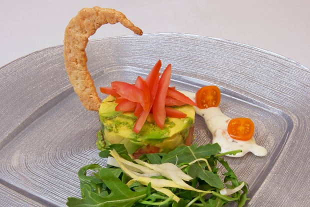 delicious gourmet kosher salad featuring a crispy crescent moon cracker prepared by danziger kosher catering and served on a circle square charger plate