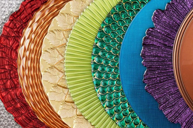 a huge photo montage of designer charger plates from mandarin orange trading company, all arranged in a rainbow