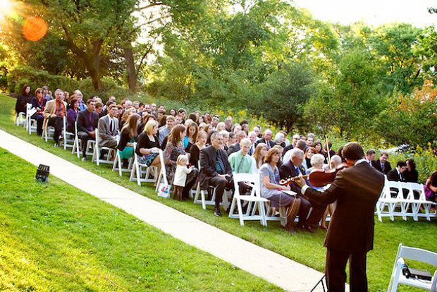 an outdoor wedding ceremony at the highland park community house